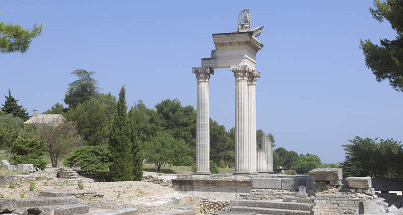 Glanum was a sacred Celtic water sanctuary turned into a religious/military Roman site about 2000 years ago. It was sacked and lost by barbarians in the third century AD. Van Gogh's olive trees grew over part of it. It was rediscovered in the last century and excavated.