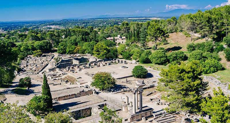 Overview of the ruins of the Roman site of Glanum, just south of St Remy de Provence in France. The timeline of Glanum runs from the 6th century BC, its founding, to 27BC, when the Romans acquired it, to 260AD, when the Romans left it.  AdobeRGB colorspace.