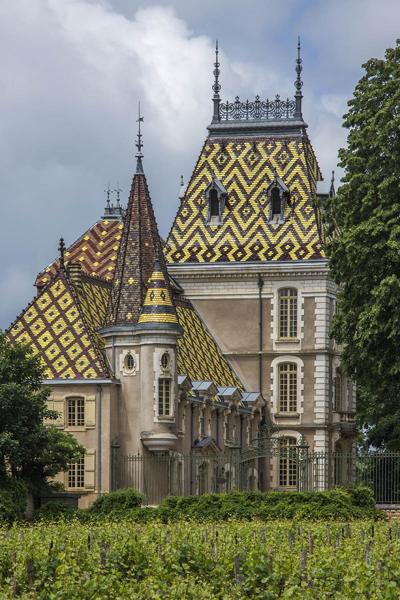 Beaune, France - June 4, 2012: The ornate roof tiles of the Aloxe-Corton Chateau near Beaune in the Champagne-Ardenne region of France.