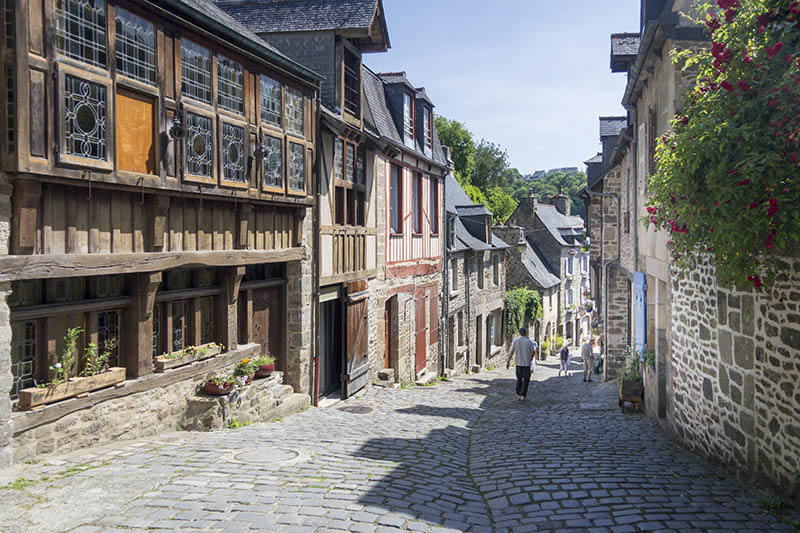 Dinan, France - June 16, 2015: Medieval cobbled street and buildings in the city of Dinan, Brittany, France