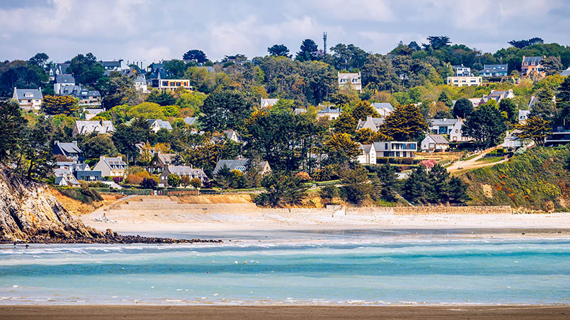 Beautiful village of Morgat with the sand beach and rocky coastline, Finistere, Brittany (Bretagne), France.