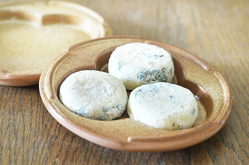 French Picodon goat cheese in specially made terracotta container, which keeps this Drome Provencale cheese at its best.