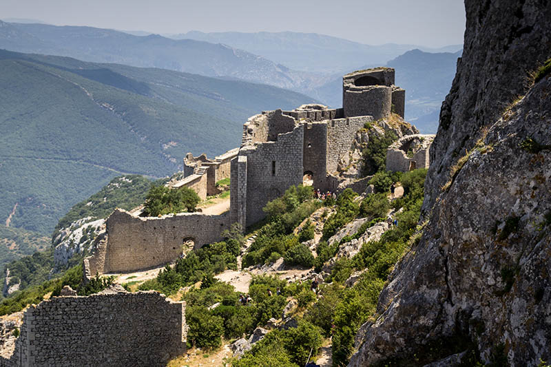 Duillac-sous-Peyrepertuse, France - July 24, 2013: Chateau de Peyrepertuse in Duillac-sous-Peyrepertuse is one of the largest of the Cathar castles in Aude, Languedoc-Roussillon and is a significant tourist attraction in the region.  The top of the castle is only accessible by foot and is quite a climb.