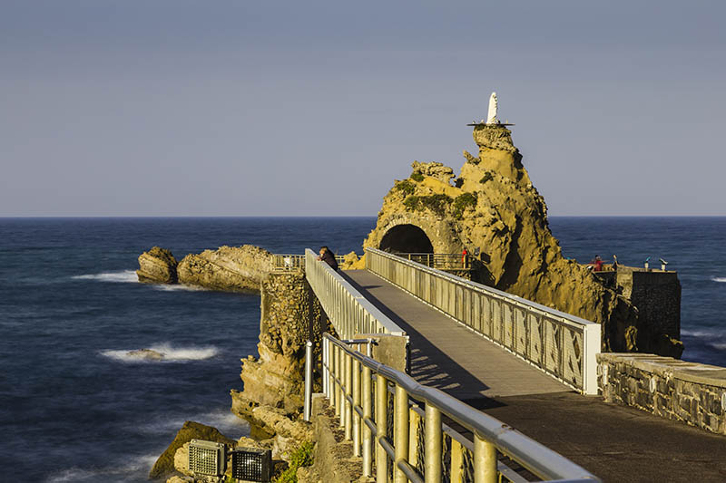 Bridge to the Rocher de la Vierge rock in Biarritz, France. Image taken as a long exposure.