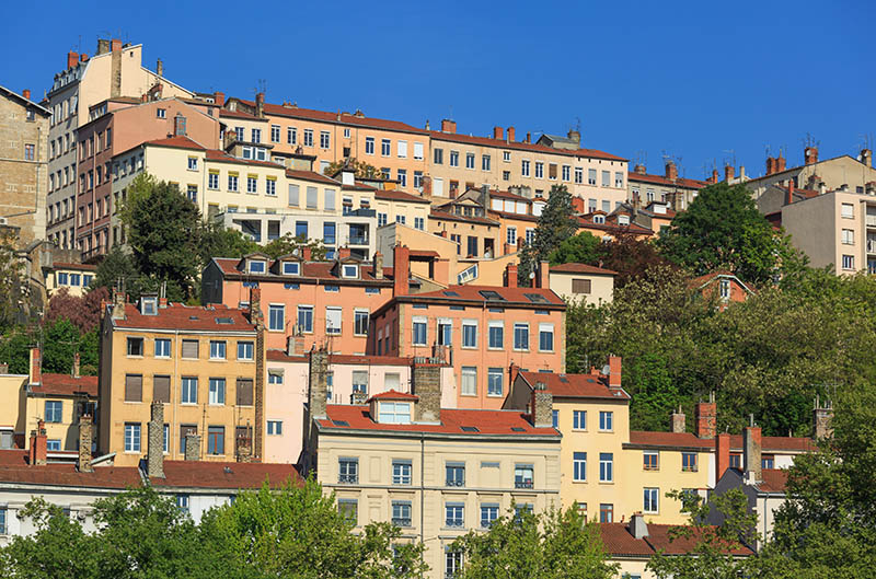 The colorfull, old apartments of Croix Rousse, the famous first arrondissement of Lyon, France.