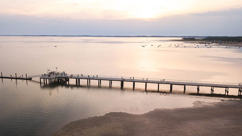 ARCACHON BAY (France), aerial view of The village and the jetty of Andernos Les Bains