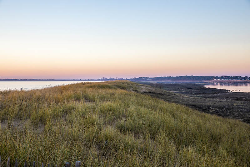 view of sunset over beach of l'Aiguillon sur Mer and the lagoon of nature reserve Casse de la Belle Henriette, Vendee, Franceview of sunset over beach of l'Aiguillon sur Mer and the lagoon of nature reserve Casse de la Belle Henriette, Vendee, France