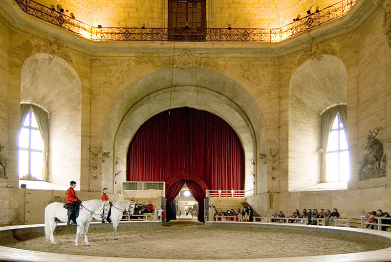 Interior ring of Grand Stables with two riders. Chantilly. France