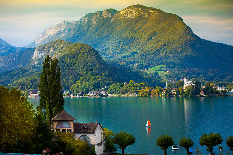 Annecy Lake with sailboat in Europ at dusk