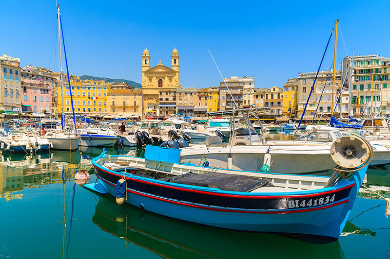 Fishing and yacht boats anchoring in Bastia port in summer season. This port connects Corsica with Italy and France mainland.