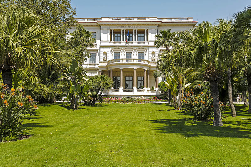 Nice, France - May 26, 2012: The Massena Palace Museum of Art and History, one of the main sights along Promenade des Anglais, was built between 1898 and 1901 by the design of Hans-Georg Tersling