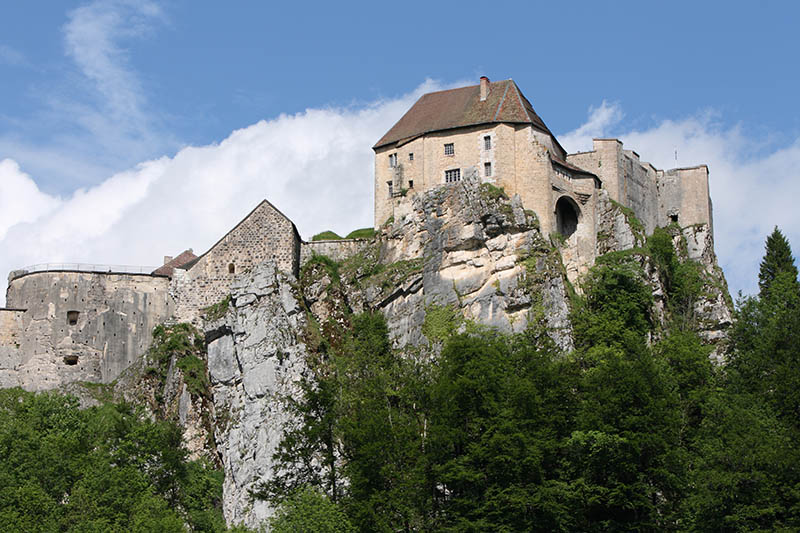 Located in La Cluse-et-Mijoux, in the Doubs département, in the Jura mountains of France, the château de Joux is best known for serving as the site of imprisonment for Toussaint Louverture, who died there on April 7, 1803.