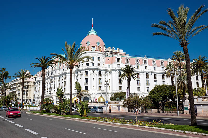 Nice, France - May 4, 2013: Luxury Hotel Negresco on English Promenade in Nice, French Riviera. Hotel Negresco is the famous luxury hotel on the Promenade des Anglais in Nice, a symbol of the Cote d'Azur
