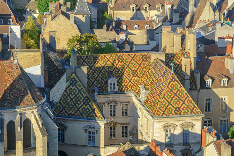 An aerial view of the historic center of the city, with a colored patterned roof, in Dijon, Burgundy, France
