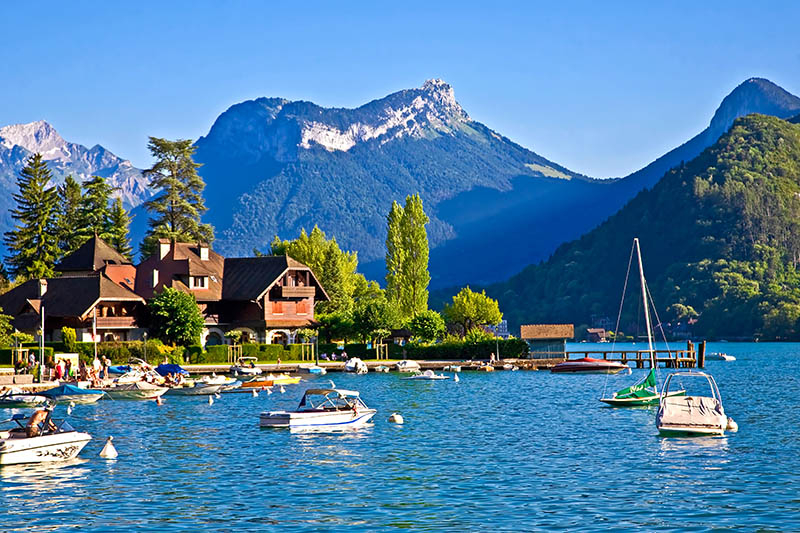 Restful town of Talloires, France, on the lake Annecy. Water sports, calm and peaceful bays and coves, swimming and relaxing.