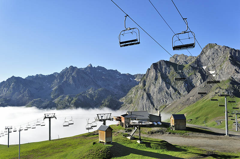 Empty chairlift in the mist at sunrise along the Col du Tourmalet in the Pyrenees, France