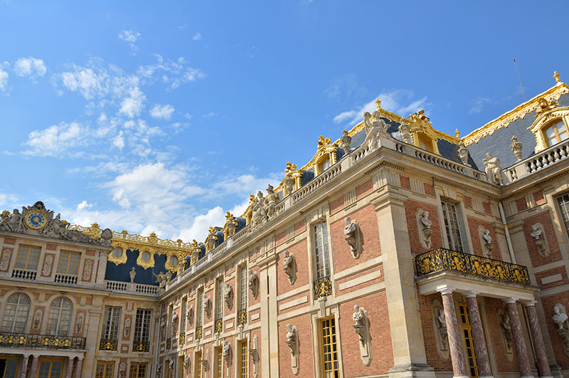 Versailles, France - July 27, 2014: Facades of the Palace of Versailles in France. It was an official residence of the kings of France and is now a World Heritage Site.