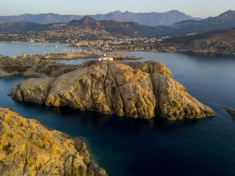 Aerial view of the Pietra Lighthouse at sunset and the Genoese tower, L'Ile-Rousse, Corsica Red Island, Corsica, France