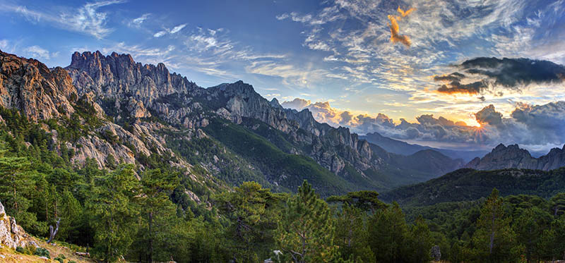 Sunrise and cloudscape over Bavella massif and mountain, Corsica, France.