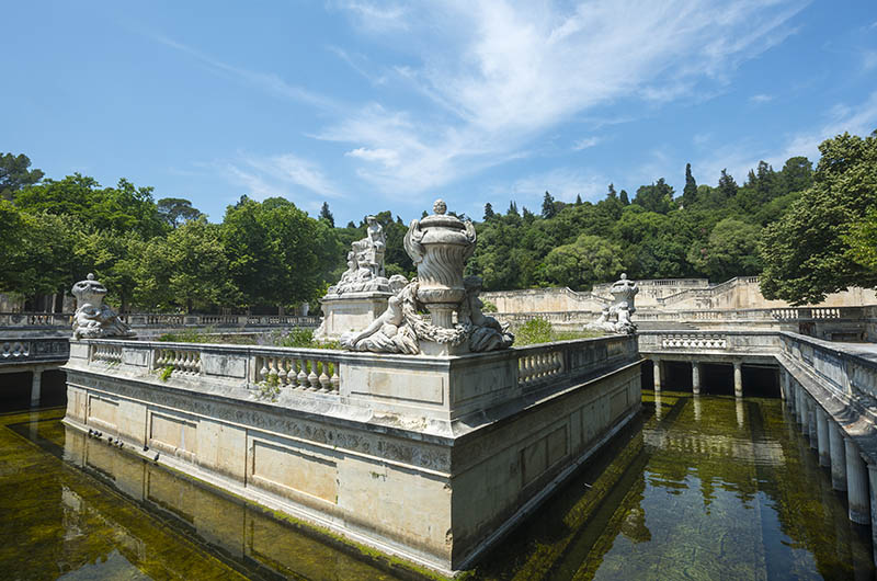 Nimes (Gard, Languedoc-Roussillon, France), statues and fountain in the park