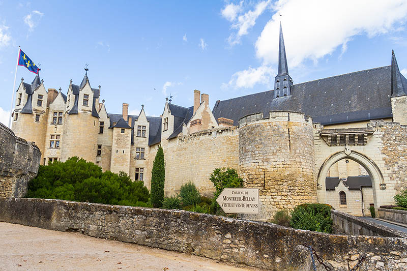 Montreuil, France - August 23, 2015: Chateau de Montreuil-Bellay - The Château de Montreuil-Bellay is a historical building in the town of Montreuil-Bellay, département of Maine-et-Loire, France, first built on the site of a Gallo-Roman village high on a hill on the banks of the Thouet River. It is listed as a monument historique by the French Ministry of Culture