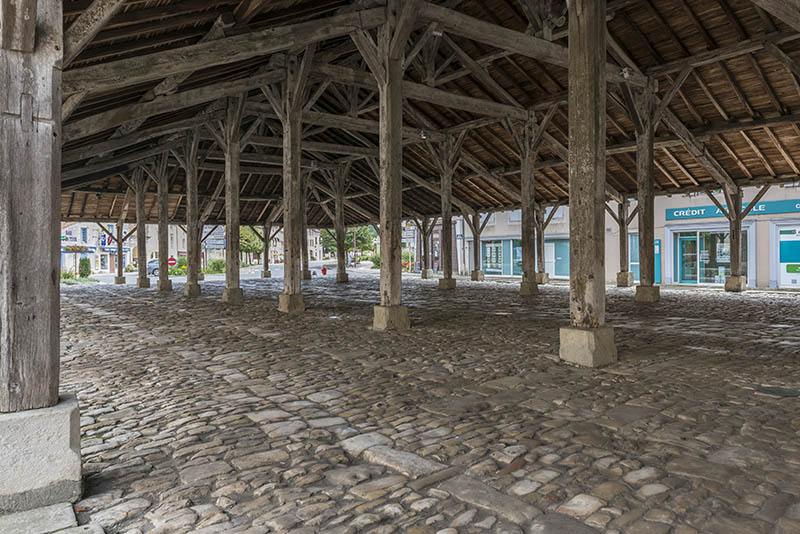 Charroux, France - August 13, 2014: Monumental, old and wooden marketplace in the center of Charroux.