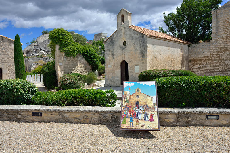 LES BAUX, FRANCE - JUL 9, 2014: Courtyard of the castle les Baux. Les Baux is now given over entirely to the tourist trade, relying on a reputation as one of the most picturesque villages in France