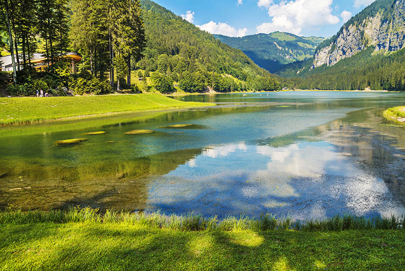 Lake of Montriond, natural lake in Haute -Savoie region,French Alps ,an attraction for many tourists,with swimming area ,fishing,canoeing.; Shutterstock ID 390675187; PO: michelin