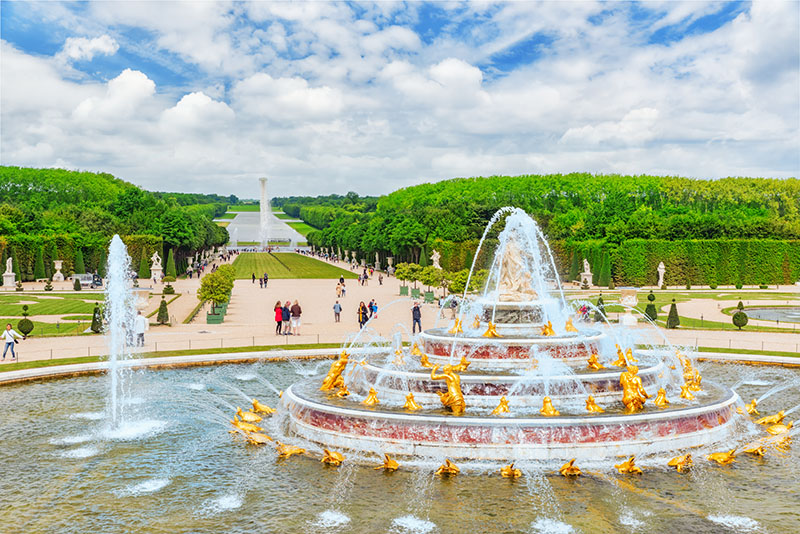 Versailles, France - July 2, 2016: Latona Fountain Pool, opposite the main building of the Palace of Versailles, created  by Sun-King Louis XIV.
