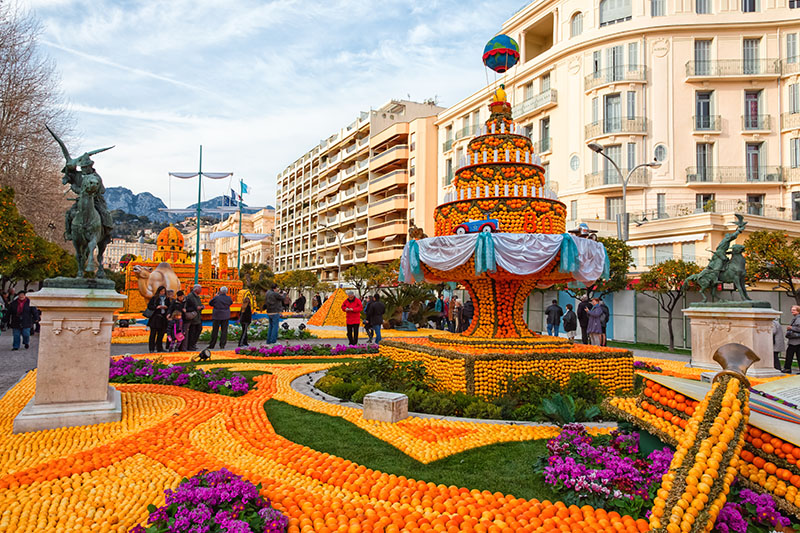 Menton, France - February 27, 2013:  80th Lemon Festival (Fete du Citron) in Menton on French Riviera.The theme for 2013 was Around the World in 80 Days: Menton, the Secret Stop.