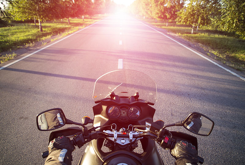 Traveling on a motorcycle on the mountain roads.
